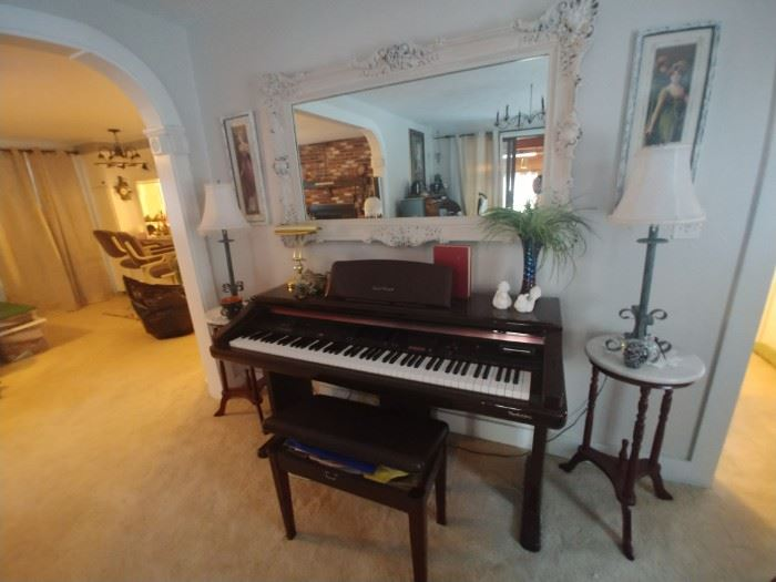 Electric piano available lamps marble-top tables and mirror have been sold