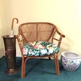 Rattan arm chair, brass umbrella stand, and planter