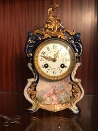 BEAUTIFUL SEVRES CLOCK WITH COBALT AND GOLD ACCENT/ PAINTED FRENCH COUPLE UNDER CLOCK FACE