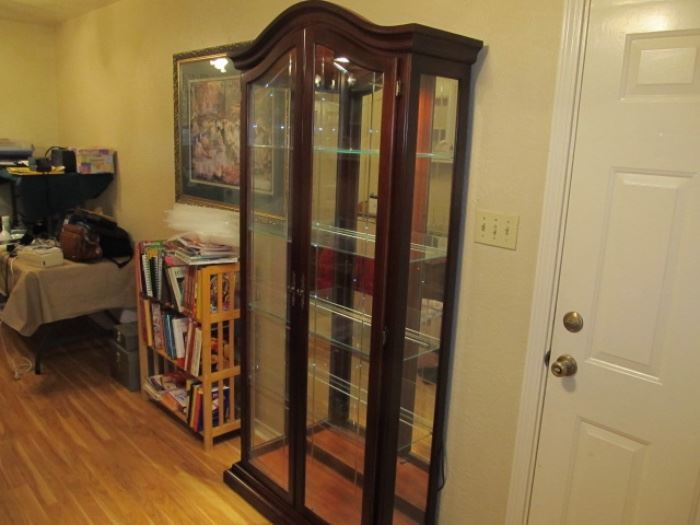 lighted curio cabinet, glass shelves, mirror back