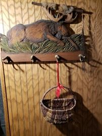 Carved wood moose wall hanging, woven basket