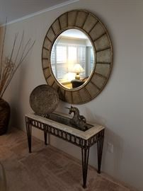 Accent table, mirror and decor