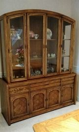 Triple China Cabinet with lights in each section, has three shelves and glass doors and storage in the bottom