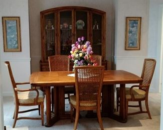 Beautiful Wood Dining Room Suite includes Table with 6 Wicker Back Chairs and a Large China Cabinet