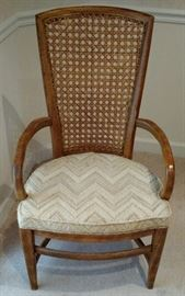 Single chair from the Dining Room Suite, showing wood arms that are on two of the Chairs