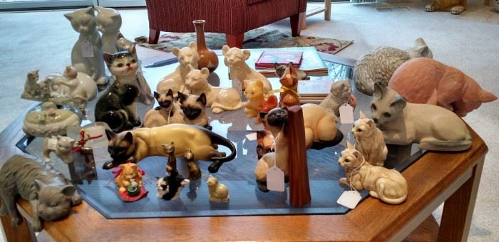 Cat figurines, large and small, all different kinds
