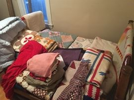 upstairs back bedroom- many antique and vintage quilts including several Amish ones