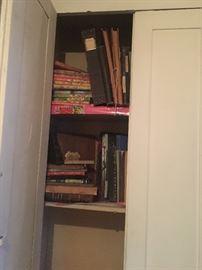 upstairs hall cupboard- books