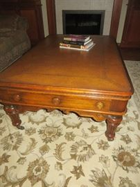 LEATHER TOP COFFEE TABLE ON COASTERS THEODORE ALEXANDER