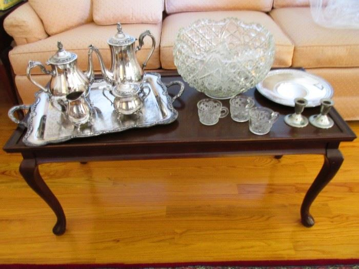 Coffee table matches end table with the Queen legs.  The tea set is silverplate along with the matching candle holders and  plate,  Glass punch bowl has 16 cups,