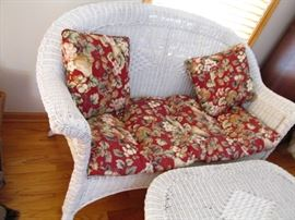 Wonderful white wicker love seat and coffee table.