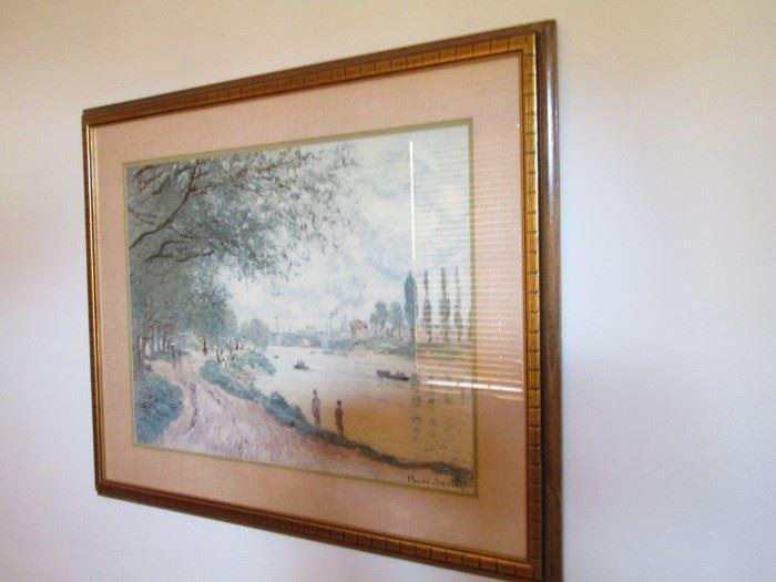 A framed Monet print.