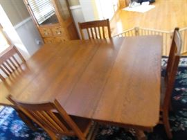 "Vintage oak table. With 3 leaves this table is only 4' 11"" long and 3' 6"" wide.  Has 4 chairs,  Take the 3  leaves out  and the table is only  30""  long."