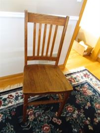 Chair that goes with table.  Look at the carpet.  Great navy color.