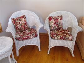 The left one is a regular wicker chair and the right is a rocker.