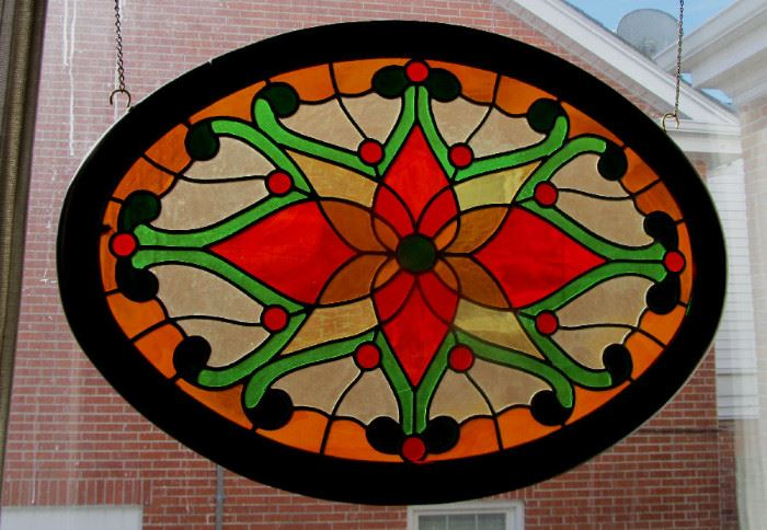 Signed antique oval stained glass panel