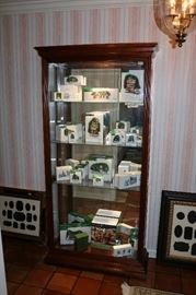 Glass and wood curio with Department 56 inside