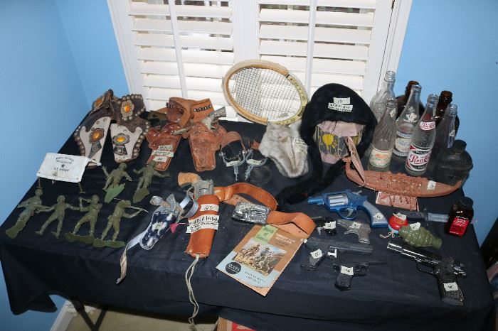 Old toys, guns and holsters, old bottles
