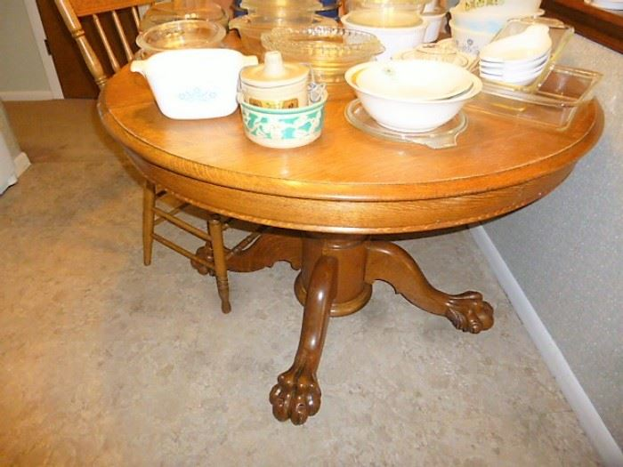 Vintage claw foot oak kitchen table & two CLEAN chairs.  $175 For the set!