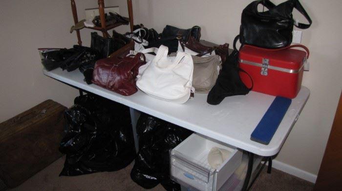 Table full of vintage  purses.