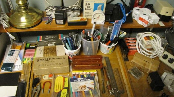 Desk full of office supplies