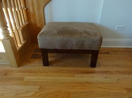 "Suede-like upholstered ottoman. 2' 3"" long x 1'9"" wide x 1'4"" tall. Good condition"