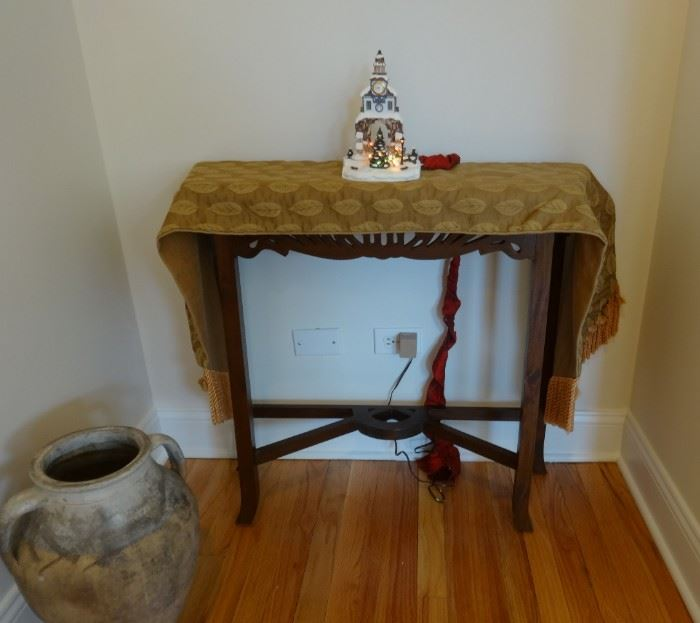"""Dark wood side table. 2'8"""" wide x 10 1/2"""" deep x 2'6"""" tall. Good condition. Not heavy.  Gold damask table runner also for sale. Village Hall light not for sale. The large jug is SOLD."""