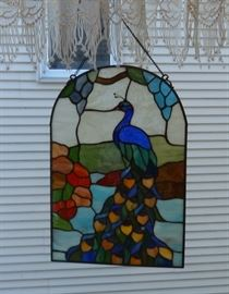 Stained glass peacock window decoration on a chain. Excellent condition.