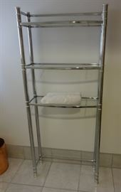 "Metal and glass shelves bathroom towel rack. Size: 5'1"" tall x 9"" deep x 2'2"" wide. Very good condition, could use a cleaning."