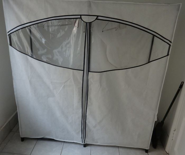 """Super-sized off-season wardrobe clothes rack, zippered case. Good condition. Size: 5'1"""" wide x 1'8"""" deep x 5'5"""" tall."""