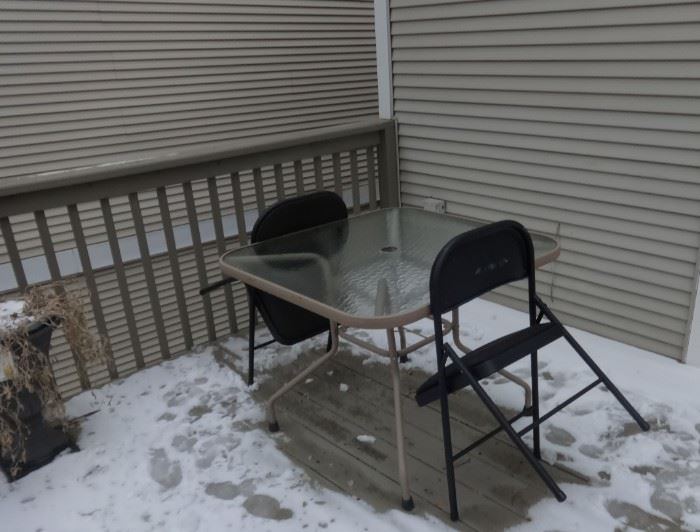Glass top Metal Outdoor Table w/hole for umbrella & 2 chairs.