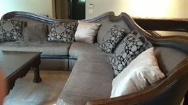 One of two large sectional sofas. Square dark  coffee table by Marg Carson.
