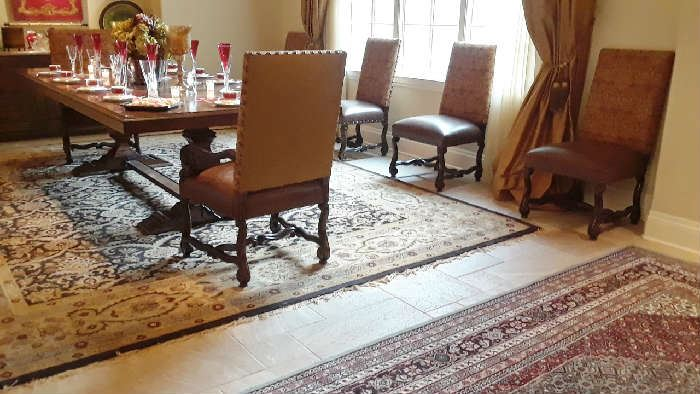 View of large rug in dining space and Persian rug in entry