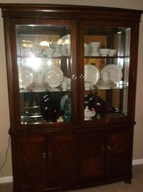 Nice large lighted china cabinet w/mirror back and glass chelves