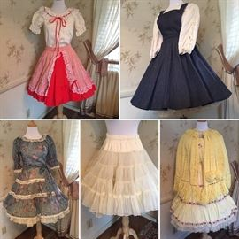 We uncovered a nice little collection of square dance or polka dresses. All in excellent condition. Plus check out that cute little crochet cape!!