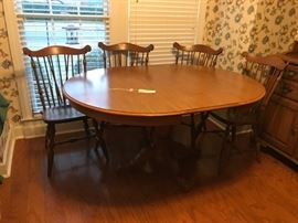 #1 round/oval pedistal maple dining table w 1 leaf and 4 spindle chairs 43-60x29  $175.00