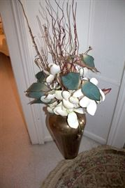 Brass vase with floral arrangement