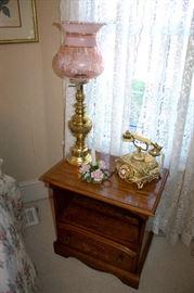 Nightstand, ornate telephone, lamp