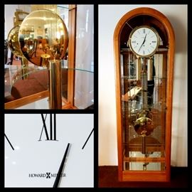 Contemporary Howard Miller grandfather clock display case, keeping excellent time!