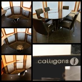 Modern dining art by Calligaris, Italy -- awesome convertible glass table!  Effortless GENIUS! 6 Connubia  black leather arm chairs