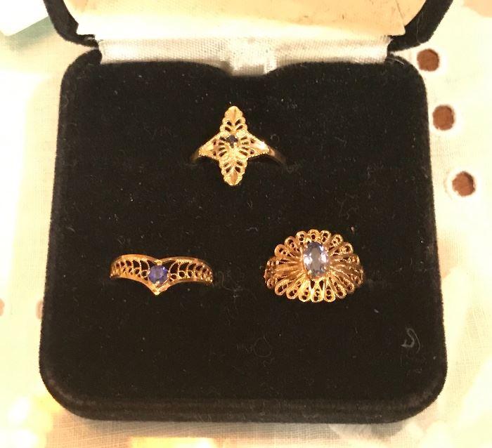 top ring- 10K yellow gold,  bottom- 2 rings 14K
