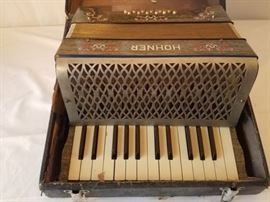 Vintage Hohner accordian and case