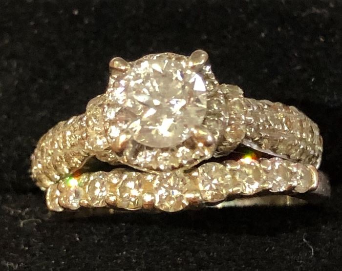 1 carat Diamond Round Brilliant Cut Solitaire surrounded by 1 carat total weight diamonds mounted in 14K White Gold .