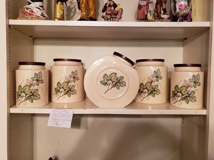 Hyalyn canister set and cookie jars.. Grape leaves