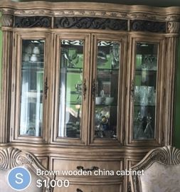 Gorgeous wooden china cabinet can be split into two parts spacious with lot of glass rack$450:00