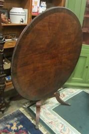 Regency tilt top dining table