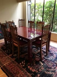 Beautiful custom dining table with antique chairs.  Dining table is finished in automotive paint for a high gloss finish