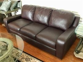 Fine Leather Château d' Ax sofa has two matching leather armchairs.  Originally over $3,000