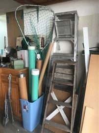 Storage for Fishing gear, Ladders, Miscellaneous pieces of wood in various sizes, Scotty reel, Downrigger mounts, and other Fishing items