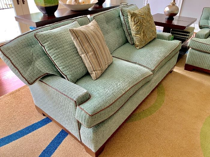 TRS sofa with custom fabric and contrast piping.